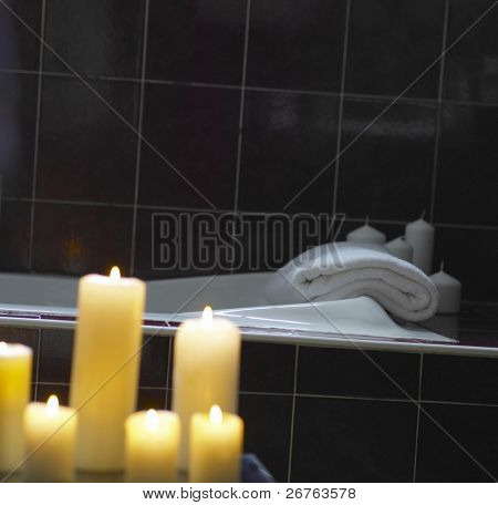stock image of candle light in the bathroom poster