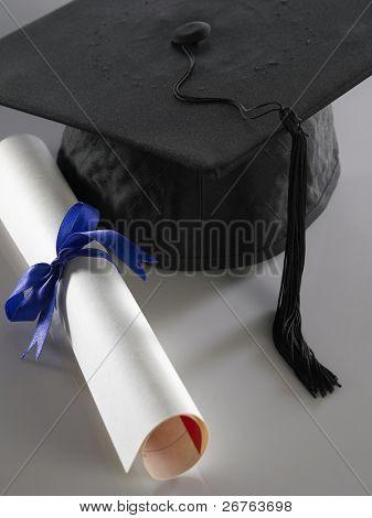 stock imageof Graduation cap and diploma poster