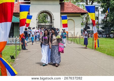 Kandy, Sri Lanka - July 19, 2016: Buddhist Devotees Visit Temple Of The Sacred Tooth Relic During Po