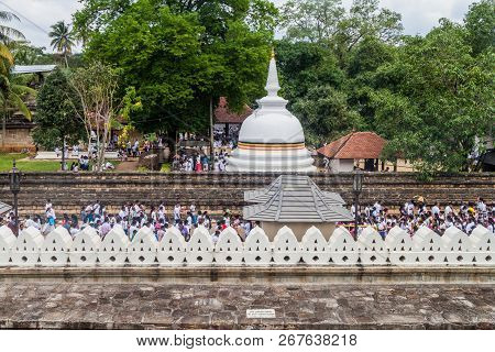 Kandy, Sri Lanka - July 19, 2016: White Clothed Buddhist Devotees At The Temple Of Sacred Tooth Reli