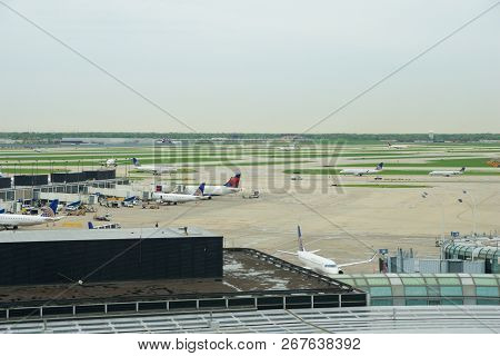 Chicago, Illinois, United States - May 11th, 2018: Several Airlines Jet Parking On Gate Position At