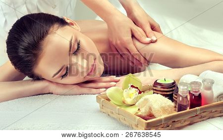 Massage And Body  Care. Spa Body Massage   Woman Hands Treatment. Woman Having Massage In The Spa Sa