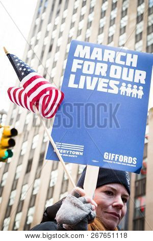 March For Our Lives: Close up of a woman holding a sign that says March For Our Lives during the march to end gun violence on 6th Ave, NEW YORK MAR 24 2018.