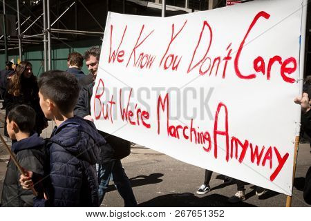 March For Our Lives: Close up of a sign that says We Know You Dont Care But Were Marching Anyway held by a protestor during the march to end gun violence on 6th Ave, NEW YORK MAR 24 2018.