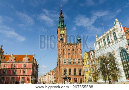 City Hall With Spire, Clock Tower, Facade Of Beautiful Typical Colorful Houses Buildings, Neptune Fo