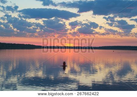 The Red Dawn Over The River. The Buoy With Red Lantern Shows Boat Where It Is Safe To Go. The Mornin