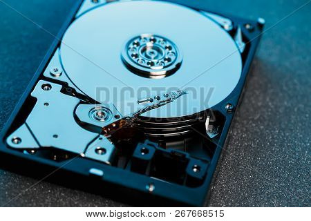 Disassembled Hard Drive From The Computer, Hdd With Mirror Effect. Opened Hard Drive From The Comput