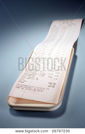 Reciept on a white tray.