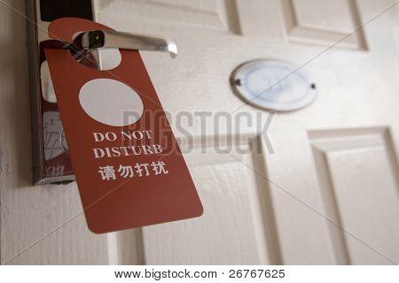 sign on the door handle do not disturb