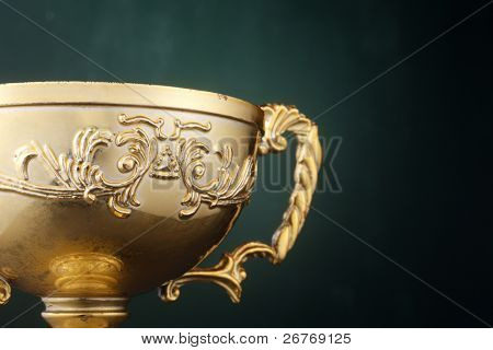 Trophy cup isolated on the green background.
