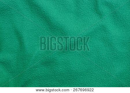 A Piece Of Green Crumpled Matter On Old Clothes