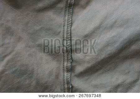 Gray Background Fabric Of Crumpled Matter On A Piece Of Old Clothes