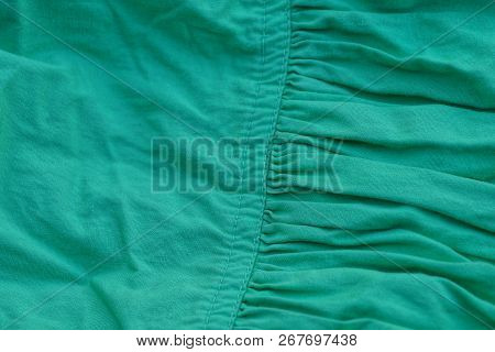 Green Fabric Texture Of Crumpled Fabric On Clothes