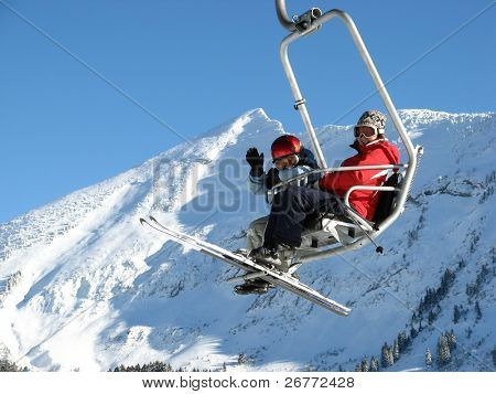 Woman with girl on the ski lift (Amden, Switzerland)