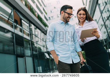 Picture Of Young Attractive Business Partners Standing