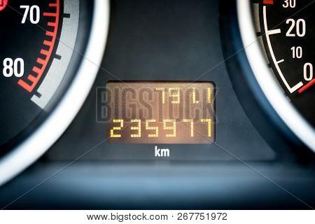 Digital Car Odometer In Dashboard. Used Vehicle With Mileage Meter. Numbers In Kilometers.
