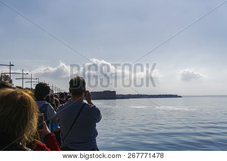 Thessaloniki, Greece - October 28 2018: Greek Air Force Helicopters Flying. Unidentified Crowd Obser