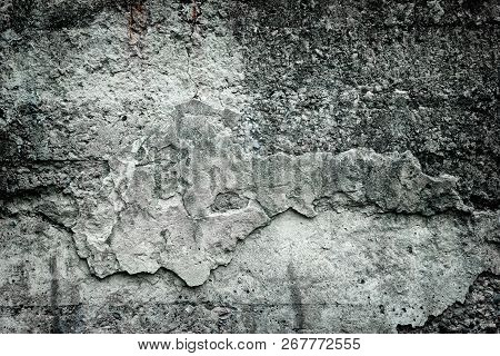 Aged Weathered Concrete Wall With Broken Fallen Off Cement. Gloomy Gray Grunge Background
