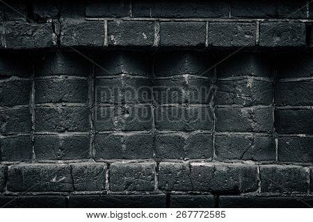 Old Weathered Black Brickwork. Brick Corners. Dark Gray Background