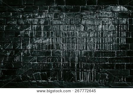 Old Black Brick Wall Drenched In White Paint. Dark Grey Grunge Background