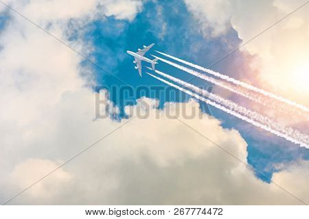 Airplane Jet Fly High In Sky, A Journey Through The Clouds And A Sunny Glare.