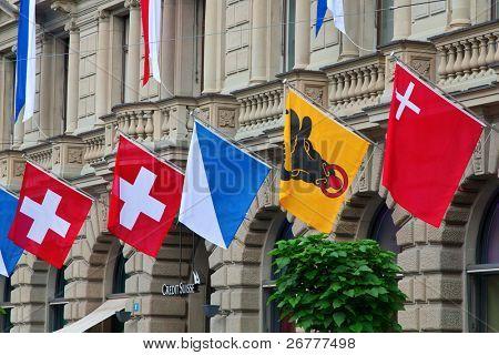 ZURICH - AUGUST 1: Swiss National Day parade on August 1, 2009 in Zurich, Switzerland. Credit Suisse headquarter decorated for Swiss National day