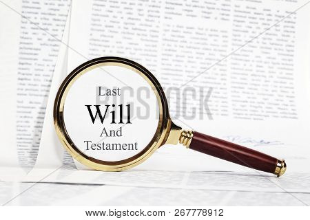 Will Concept - Paperwork Representing A Signed Will, With A Magnifying Glass Over, Highlighting Last