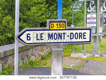 Le Mont-dore, France - July 28, 2011: A Vintage Road Sign Indicates The Direction Of The Town Of Le