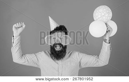 Hipster In Giant Sunglasses Celebrating Birthday. Celebration Concept. Guy In Party Hat Celebrates H
