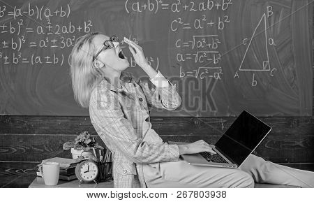 Woman Tired Teacher Work Laptop Classroom Chalkboard Background. Working Conditions For Teachers. Wo