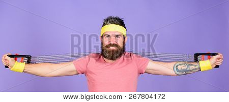 Man Bearded Athlete Exercising With Expander Equipment. Athletics Sport Concept. Sportsman Wear Retr