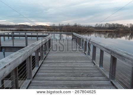Wood Fishing Dock Over Purgatory Creek At Sunset In Autumn