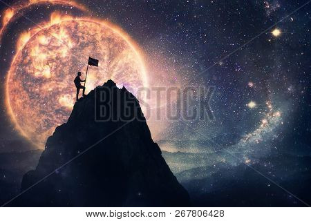 Self Overcome Concept As A Man Leader Climbing A Tall Mountain Carrying A Flag To The Top. Road To W