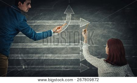 Man And Woman Sharing Thoughts Together Drawing Arrows, One Of Them Change The Direction Going Up, A