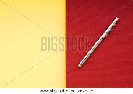 Red Book On A Yellow Background