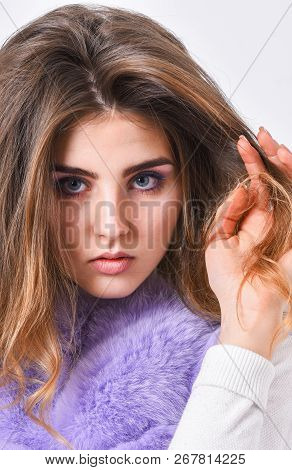 Hair Care Concept. Girl Fur Coat Posing With Hairstyle On White Background. Prevent Winter Hair Dama