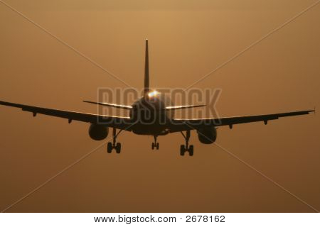 Aircraft Landing In The Sunset