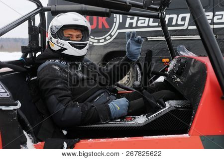 MOSCOW - MAR 2, 2018: Man in First Russian serial racing car Shortcut at snowy track, developed by 527 design office of DK Racing Company