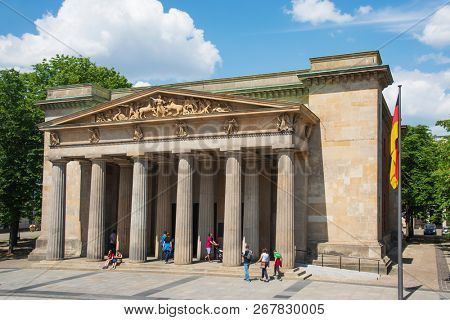 BERLIN, GERMANY - MAY 25, 2018: A view of the facade of the Neue Wache in Berlin, Germany, which serves as Central Memorial of the Federal Republic of Germany for the Victims of War and Dictatorship