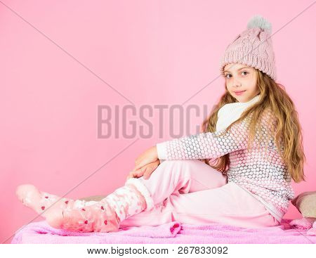 Kid Girl Wear Cute Knitted Fashionable Hat And Comfortable Cozy Clothes. Girl Long Hair Relaxing Pin