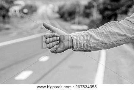 Most Popular Way Of Hitchhiking Is To Thumb Up. Hand Thumb Up Gesture Try Stop Car Road Background.