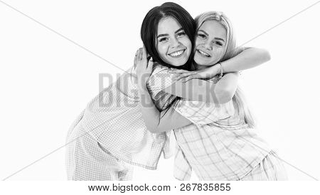 Girls Hugging Tight, Isolated On White Background. Sisters Or Best Friends In Pajamas. Sisters Best