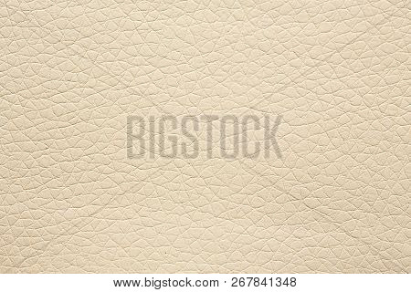 Gentle beige leatherette background. Beige texture on macro. poster