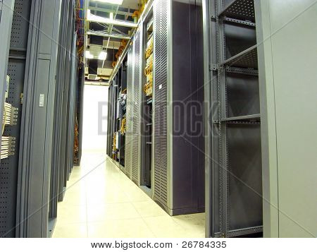 a shot of network  cabinet and servers in a technology data center