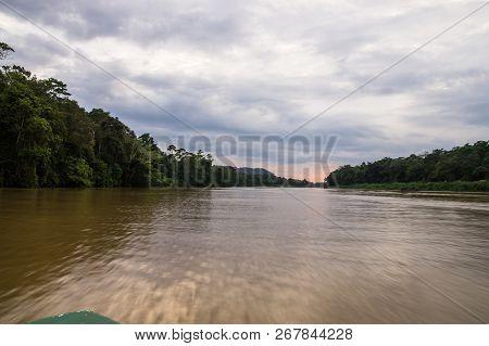 Boat Trips Along The Overgrown Jungle Of The Kinabatangan River, Sabah, Borneo. Malaysia.