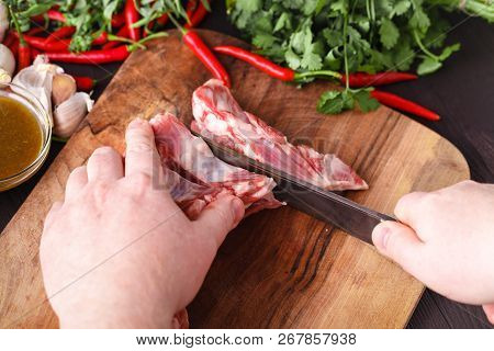 Chef Butcher Cutting Lamb Meat With Knife On Kitchen, Cooking Proteine Food