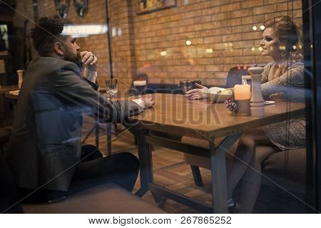 Business Meeting Of Man And Woman. Couple In Love At The Restaurant. Valentines Day With Sexy Woman