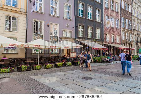 Gdansk, Poland - September 2, 2016: People Walk Along Historic Houses At Dlugi Targ Square In Gdansk