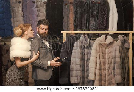 Couple In Love Among Fur Coat, Luxury. Date, Couple, Love, Man And Woman. Woman In Fur Coat With Man
