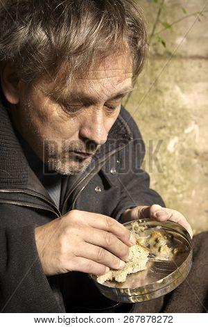 Ugly Pauper Man Living Outdoor Eating Lentil Soup On Street